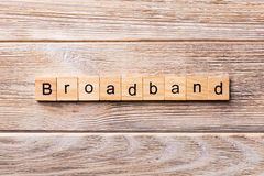 BROADBAND word written on wood block. BROADBAND text on wooden table for your desing, concept.  royalty free stock images