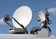 Broadcast antenna and dish Royalty Free Stock Images