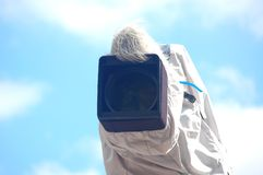Broadcast camera with cover. Broadcast camera with protective cover against a blue cloudy sky Royalty Free Stock Photo