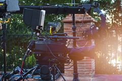 Broadcast camera at outdoor in stage with light and crane camera royalty free stock images