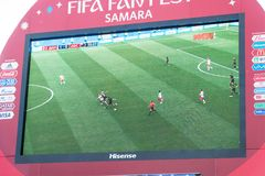 Broadcast of the match Denmark-Australia on the screen in the fan zone of the world Cup 2018. SAMARA, RUSSIA - JUNE 21, 2018: Broadcast of the match Denmark Royalty Free Stock Images