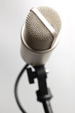 Broadcast microphone. Television broadcast microphone. Isolated over white Royalty Free Stock Photos