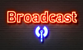 Broadcast neon sign on brick wall background. Royalty Free Stock Photos