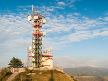 Broadcast relay station. A broadcast relay station for television and radio broadcasting on the summit of mount Fasce, near Genoa Stock Photos