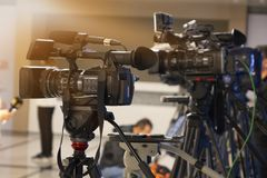 Broadcast television studio camera and crane camera in news studio room royalty free stock photography