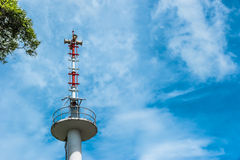 Broadcast tower on Blue sky. With big clouds and  free space for your text Stock Photo