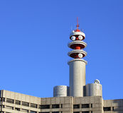 Broadcast tower on building. With blue sky Royalty Free Stock Photo