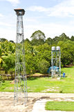 Broadcast tower and water tank Royalty Free Stock Photo