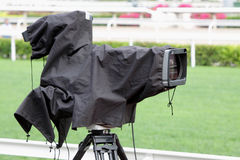 Broadcast TV Camera. With Rain Cover Royalty Free Stock Photo