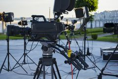 Broadcast tv; movie shooting or video production and film, tv crew team with camera. Light and audio equipment at outdoor location Royalty Free Stock Images