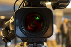 Broadcast video camera camcorder back in the studio TV show. Broadcasting, producers. stock photo