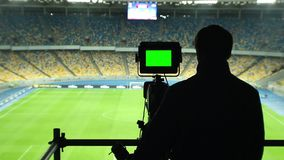 Broadcasting football match TV camera, green screen, coverage. Stock footage stock video footage