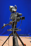 Broadcasting TV Camera. A professional broadcasting television camera in front of a blue screen in a studio royalty free stock photography