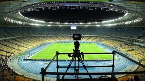 Broadcasting TV camera stadium arena after football match, fans. Stock footage stock video footage