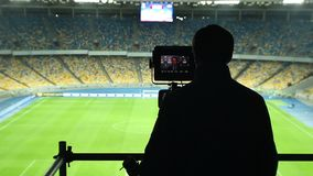 Broadcasting TV cameraman shooting covering football match, fans. Stock footage stock video footage