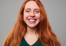 Broadly smiling redhead woman with freckles Stock Photography