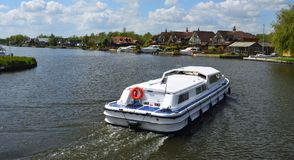 Broads Cruiser on the river Bure at Horning. Norfolk England royalty free stock image