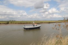 A Broads Ranger. Broads rangers are a familiar sight on the waters of the Broads and perform a valuable role. Ten full time rangers patrol five main areas of the royalty free stock photography
