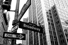 Broadway Arrow One Way Street Crossing with West Street 32. In USA Stock Photo