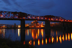 The Broadway bridge & grain elevators at dusk. Royalty Free Stock Images
