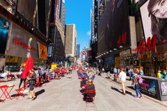 Broadway in Manhattan, New York City. New York City, USA - October 06, 2016: Broadway with unidentified people in Manhattan. Its the oldest north–south main Stock Photos