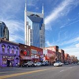 Broadway Nashville. The At&t Building towers over Honky-tonks on Lower Broadway June 16, 2013 in Nashville, Tennessee. The district is famous for the numerous Stock Photo