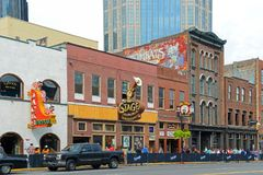 Broadway, Nashville, Tennessee, USA. Honky tonk Bars on historical Broadway in downtown Nashville, Tennessee, USA. Lower Broadway is famous for entertainment Royalty Free Stock Images