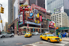 On Broadway, New York. NEW YORK CITY - JUNE 15, 2015: Yellow cabs in Broadway, a busy tourist intersection of commerce Advertisements and theaters. One of the Royalty Free Stock Photos