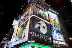 Broadway show advertisements. Corner of Times Square at 7th Avenue showing advertisement billboards for Broadway shows in Manhattan, New York City. Photo taken royalty free stock photos