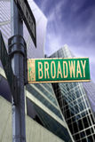 Broadway sign. In front of a skyscraper with a dramatic blue sky Royalty Free Stock Images
