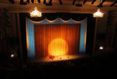 Broadway stage with spotlight. And curtain stock images