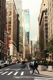 Broadway street in Manhattan`s midtown by early evening,  New York City, United States. Toned image Stock Photography