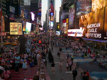 Broadway street at Times Square New York. Lights and over sized billboards at Times Square. Many tourists hang out here and enjoy the hustle and bustle Stock Photos