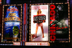 Broadway Theater Signs at Night in New York City. A tight night shot of the colorful billboards and bright lights of the Broadway shows including Legally Blonde Stock Images