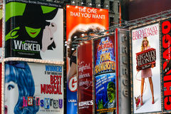 Broadway Theater Signs Times Square New York. A tight shot of the colorful billboards and bright lights of the Broadway shows including WIcker, Legally Blonde royalty free stock photos