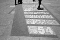 Broadway Theaters. People walking on Times Square, where the names of Broadway theaters are engraved on the ground Stock Photo