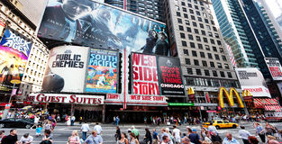 Broadway at Times Square. Corner of Times Square at 7th Avenue showing advertisement billboards for Broadway shows in Manhattan, New York City. Buildings of the Stock Images