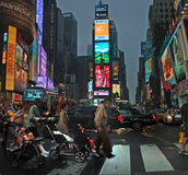 Broadway at Times Square New York City, USA. A family takes an evening stroll on a warm Fall evening at Times Square royalty free stock images