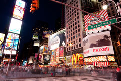 Broadway at Times Square by Night. Night scene of Broadway at Times Square in Manhattan (New York City) with all the lit up billboards and advertisements, and stock photo