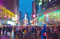 Broadway Times Square at night, New York. NEW YORK, MARCH 14, 2015: Times Square at night - Busy Broadway with animated signs for the Lion King and other shows Stock Photo
