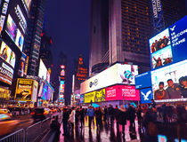 Broadway Times Square at night, New York. NEW YORK, MARCH 14, 2015: Times Square at night - HDR featuring busy Broadway with animated signs for the Lion King and Royalty Free Stock Photos