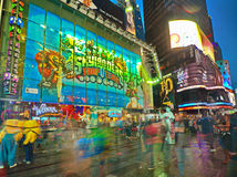 Broadway Times Square at night, New York. NEW YORK, MARCH 14, 2015: Times Square at night - HDR featuring the famous Toys R Us flagship store and busy Broadway Royalty Free Stock Photo