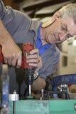 Broca do trabalhador e de mão Fotografia de Stock Royalty Free