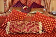 brocade cushions red Arkivbilder