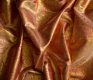 Brocado de la tela, color anaranjado de oro Imagenes de archivo