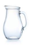 Brocca di vetro su una priorità bassa bianca fotografia stock