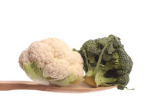 Broccol and a mini cauliflower on a wooden spoon Stock Photography