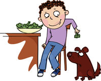 Broccoli. The funny boy feeds the dog broccoli Royalty Free Stock Photography