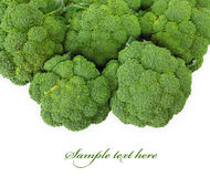 Broccoli. Green broccoli is isolated on a white background Stock Photos