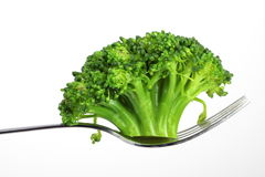 Broccoli. On a fork over white background Royalty Free Stock Photos